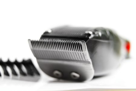hair clippers: closeup of hair clippers and guide, on white