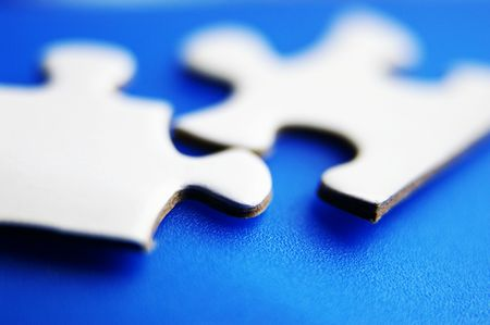 closeup of two puzzle pieces fitting together photo