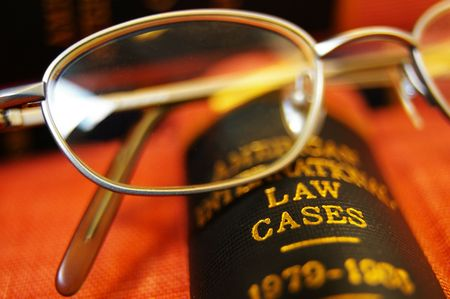 Closeup of open law book and glasses Stock Photo - 3699261