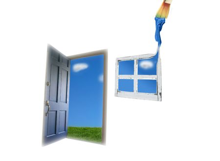 Door opening to green grass and blue sky, and painted window photo