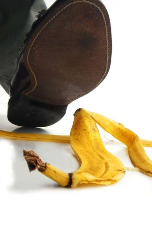 Walking man about to step on a banana peel photo
