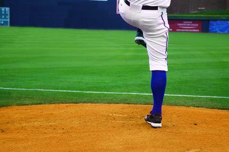 pro baseball pitcher on the mound, ready to throw photo