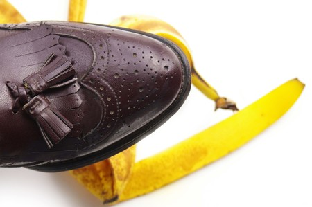 Person about to step on a banana peel photo