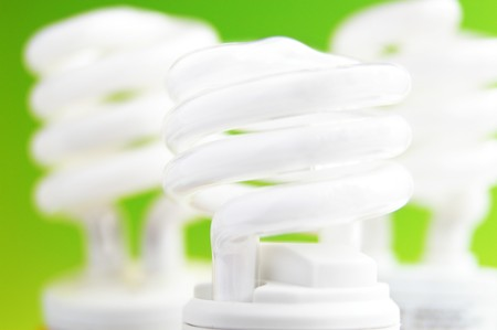group of compact fluorescent light bulbs on green background Stock Photo - 4023562