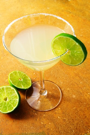 twist: Margarita  martini with a twist of lime on textured background