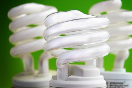 energy efficient: energy efficient light bulbs on green background