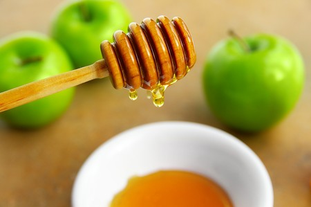 Honey drip and apples Stockfoto