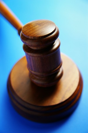 arbitrater: wooden judges gavel from above, on blue