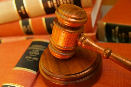 arbitrater: Judges gavel on a pile of law books
