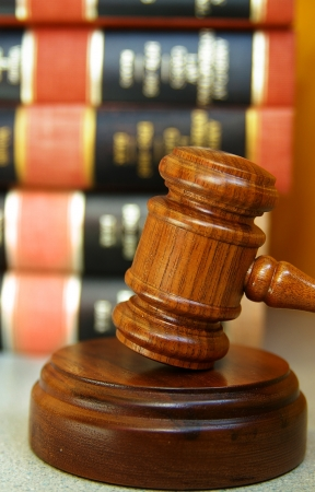 arbitrater: Judges gavel with a stack of law books Stock Photo