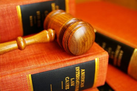 arbitration: judges gavel on a pile of law books