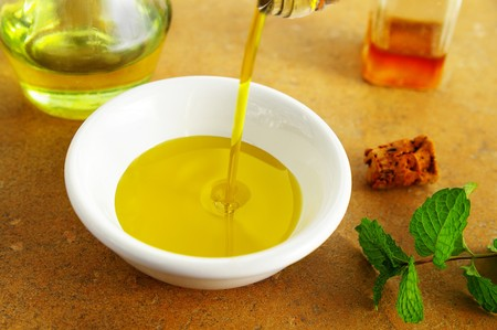 cooking oil: Olive oil pouring into a bowl