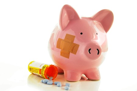 bandaged: Bandaged Piggy bank with pills(healthcare costs)