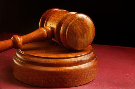 arbitrator: closeup of a judges wooden court gavel