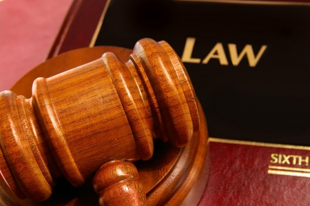 judgments: law book and judges gavel closeup from above Stock Photo