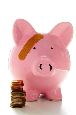 Piggy bank with band-aid. Symbolizes health-care costs photo