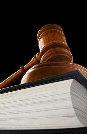 judge's court gavel on a law book, on black Stock Photo - 4673648