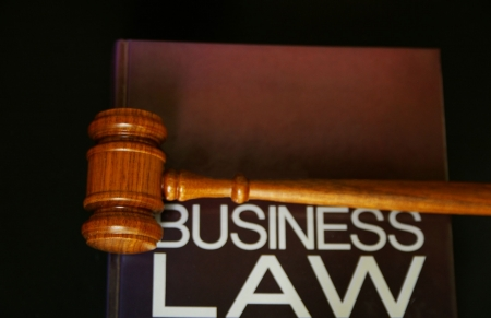 judges gavel on a business law book photo