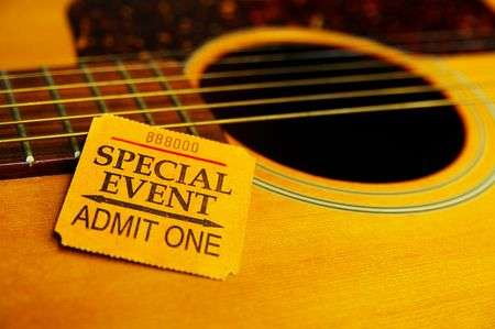 Closeup  of a special event ticket stub on a guitar photo