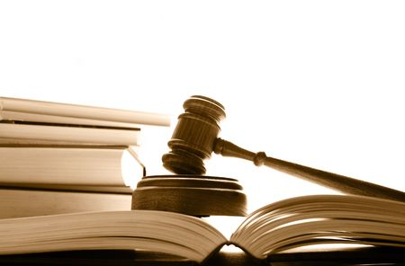 judges court gavel on law books, over white photo