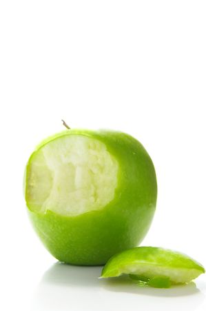 green apple on white, with a bite taken out photo