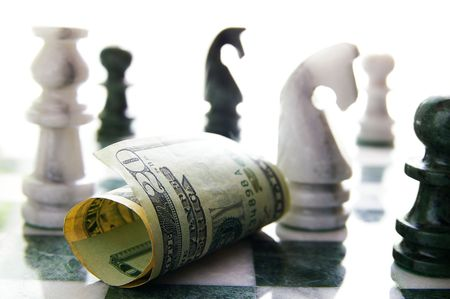victor: twenty dollar bill on a chess board (investment or financial risk)