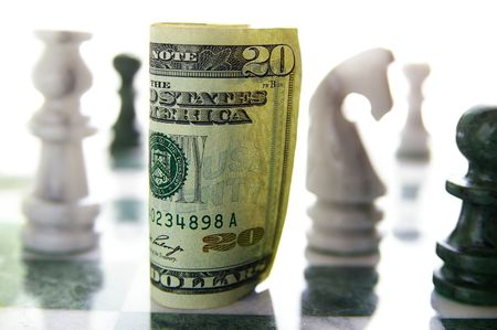 american twenty dollar bill on a chess board (financial risk or investment) photo