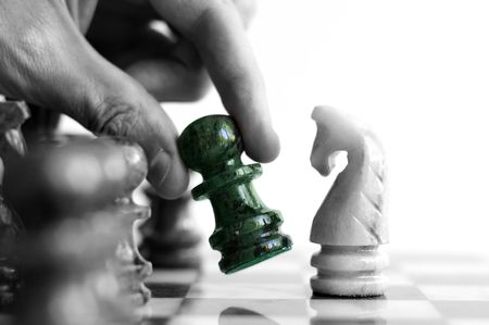 Moving a chess piece (in color) across the board Stock Photo - 4962713