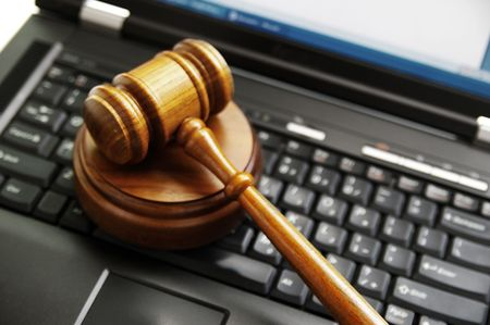 computer law: judges gavel on a laptop computer (cyber law)