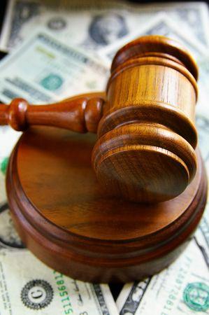 closeup of judges court gavel, over american money