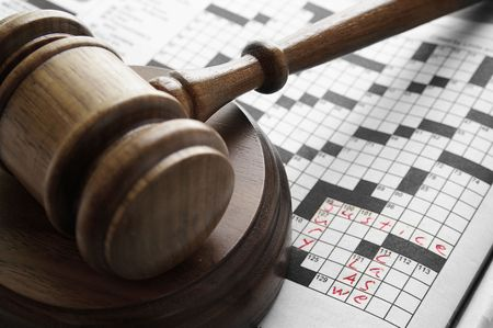 crossword puzzle with legal terms, and judges court gavel