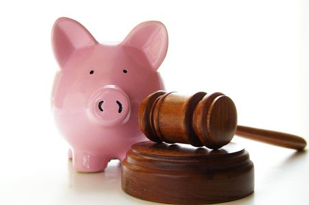 judges court gavel and piggy bank, on white