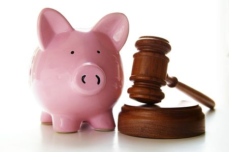 arbitrater: judges court gavel and piggy bank, on white