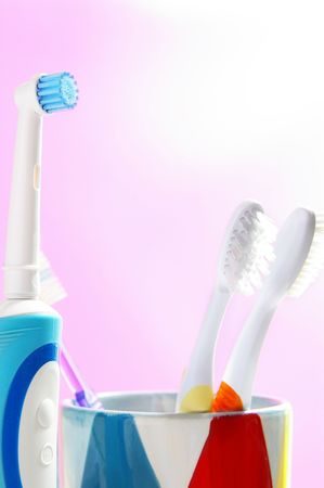 assorted tooth brushes, an  electric and regular