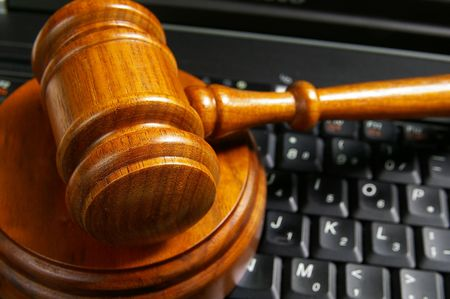 closeup of judges gavel on laptop computer Stock Photo
