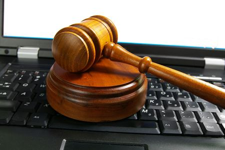 judges court gavel on a laptop computer (cyber law) photo