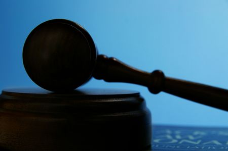 arbitrater: judges court gavel silhouette on blue background Stock Photo