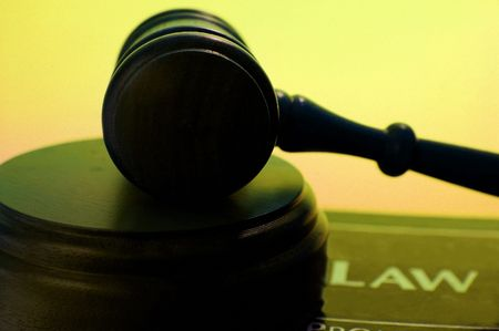 arbitrater: judges court gavel on a law book, against blue background