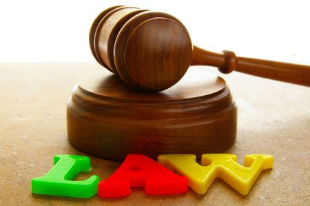 court gavel with colored play law letters