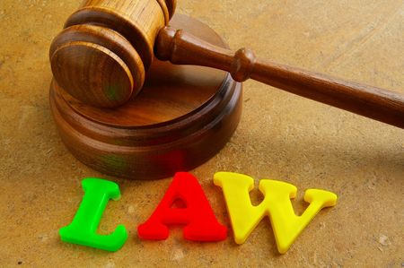 court gavel and play letters spelling
