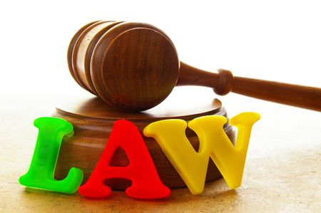 court gavel with play letters spelling