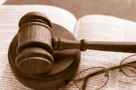arbitrater: judges court gavel on a law book with glasses