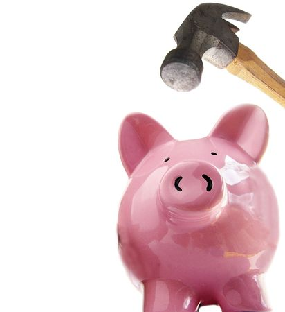 ira: Piggy bank about to be smashed open by hammer