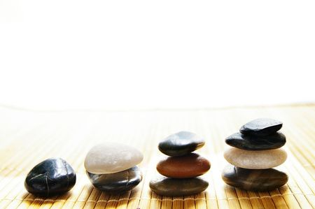group of balancing stones from one to four photo
