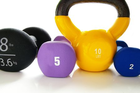 assorted weights in a row, isolated on white Stock Photo