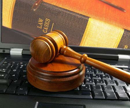 computer law: judges court gavel on a laptop computer (cyber law)