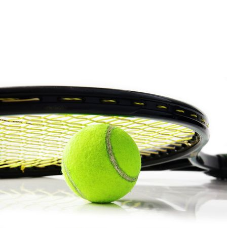 Closeup of a tennis racket and ball, on white