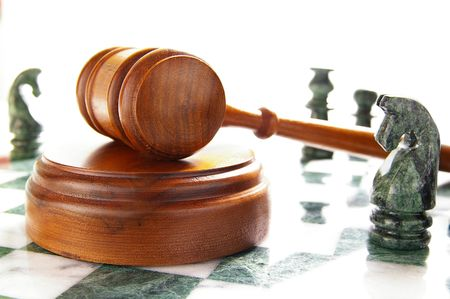 chess pieces and law gavel, over white Stock Photo