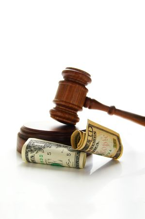 arbitrater: judges court gavel with money (law suit)