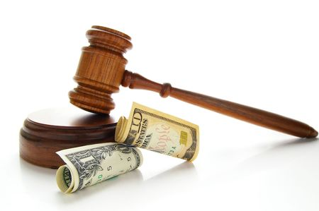 law gavel with cash, isolated on white